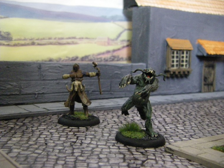 Photos of Marcus and a Silurid in Home made Malifaux City Terrain Painted, Wyrd Games