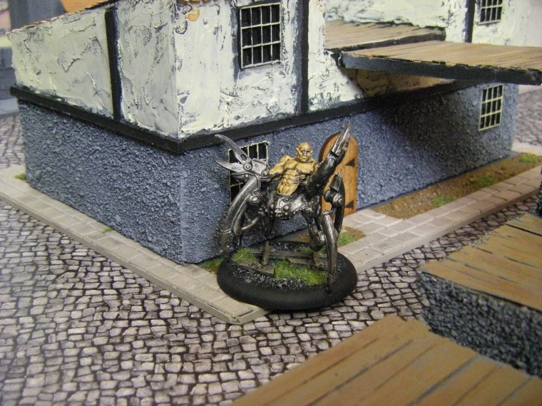 Photos of Howard Langston in some home made Malifaux City Terrain Painted, Wyrd Games