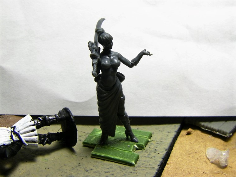 32mm Malifaux Wyrd Games Arcanist Cassandra being painted