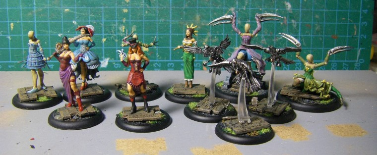 32mm Malifaux Wyrd Games Arcanist Colette Crew being painted